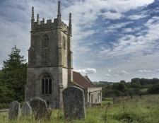Imber. Wiltshire's Ghost Village.  Situated in the middle of Salisbury Plain and taken over by the Army in 1943 it has never been returned to the villagers.  All that really remains now is the church. Open for one weekend a year.